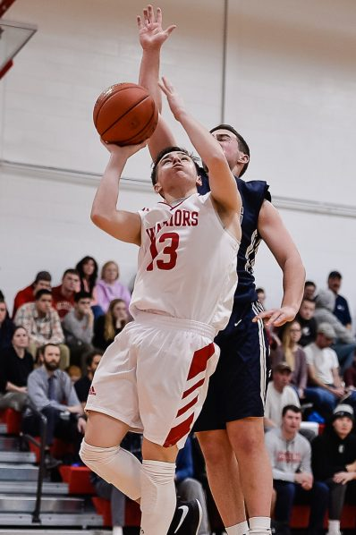 Wamogo's Ben Roy #13 goes up for a shot against Shepaug's Joseph Brunelli #23 during a BL basketball game in the Litchfield Hills Holiday Claasic between Shepaug and Wamogo at Wamogo High School in Litchfield on Thursday. Bill Shettle Republican-American