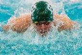 Holy Cross swimmer Alex Ford competes in the 100 yard butterfly during a NVL Swim meet between Hand and Holy Cross at Kennedy High School in Waterbury on Friday. Bill Shettle Republican-American