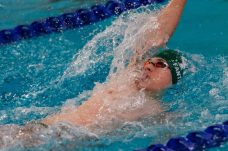Holy Cross swimmer Derek Fantano competes in the Men's 100 Yard Backstroke final during a NVL Swim meet between Hand and Holy Cross at Kennedy High School in Waterbury on Friday. Bill Shettle Republican-American