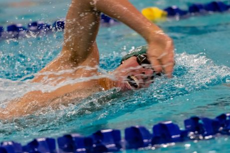 Holy Cross swimmer Sam Mason competes in the Men's 400 Yard Freestyle Relay final during a NVL Swim meet between Hand and Holy Cross at Kennedy High School in Waterbury on Friday. Bill Shettle Republican-American