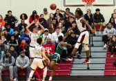 Sacred Heart's Jamaal Waters #11 blocks the shot of Weaver's Ta'Ki Blizzard #2 during a non-league intersectional basketball game betwwen Weaver and Sacred Heart at Sacred Heart High School in Waterbury on Friday. Bill Shettle Republican-American