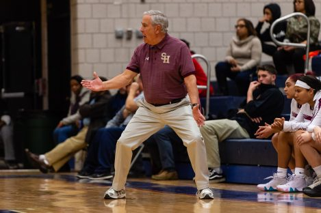 Sacred Heart head coach Ron Picard yells out defensive instructions to his team, during a non-league girls basketball game between Brooklyn Democracy Academy and Sacred Heart in the Mustapha Heron Holiday Tournament at Crosby High School in Waterbury on Saturday. Bill Shettle Republican-American