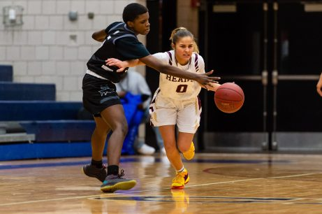 Sacred Heart's Aamya Rivera #0 dribbles up court holding off Brooklyn's Zanobia Graham #5, during a non-league girls basketball game between Brooklyn Democracy Academy and Sacred Heart in the Mustapha Heron Holiday Tournament at Crosby High School in Waterbury on Saturday. Bill Shettle Republican-American
