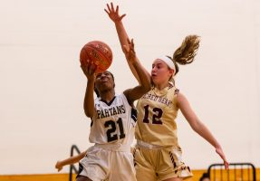 WCA's Jonna Pierre #21 drives to the basket against Sacred Heart's Hayley Tucker #12 during a NVL Girls Basketball game between Sacred Heart and WCA at the Waterbury Career Academy in Waterbury on Thursday. Sacred Heart ending up beating a pesky WCA team 43-31. Bill Shettle Republican-American