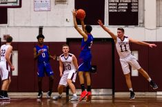 Crosby's Jordan Santos #3 shoots a three point shot in front of a lunging Torrington's TJ Callabrese #11 during a NVL Boys Basketball game between Crosby and Torrington at Torrington High School in Torrington on Wednesday. Bill Shettle Republican-American