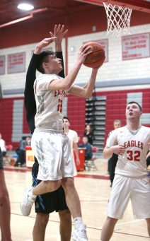 Wolcott High School's Brian Perzhilla goes up for a shot in front of teammate Jack Drewry during the varsity basketball game in Wolcott against Oxford High School on Wednesday night. Emily J. Reynolds. Republican-American