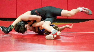 Pomperaug's Joey Mastroianni pinned Newtown's Greg Gargano in 1:56 to win the 106 lb. class during their meet Thursday at Pomperaug High School in Southbury. Jim Shannon Republican American