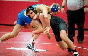 Pomperaug's Daniel Marquis shoots the legs of Newtown's Ayden Kasbarian as they compete in the 154lb. class during their meet Thursday at Pomperaug High School in Southbury. Kasbarian defeated Marwuis 5-2 to win the match. Jim Shannon Republican American