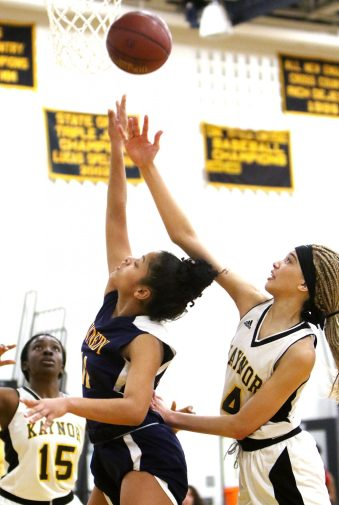 #11 Shyan Perez of Kennedy High puts up a shot as #4 Antia Ozuna of Kaynor Tech. defends during basketball action in Waterbury Monday. Steven Valenti Republican-American