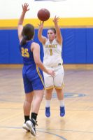 Gilbert High School's Jillian Wexler goes up for a shot over Housatonic Regional High School's Christina Winburn during the girls varsity basketball game on Tuesday night. Emily J. Reynolds. Republican-American