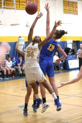 Gilbert High School's Dileysi Sarmiento and Housatonic Regional High School's Sydney Segalla battle for the ball during the girls varsity basketball game on Tuesday night. Emily J. Reynolds. Republican-American