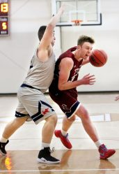 #33 Kai Kostmayer of Taft drives to the basket as #42 Connor Garrahy of Kent defends during basketball action in Watertown Wednesday. Steven Valenti Republican-American