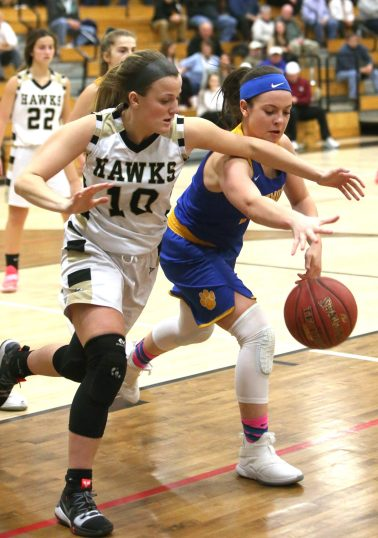 Woodland High School's #10 and Seymour High School's Morgan Teodosio battle for the ball during the girls varsity basketball game at Woodland Regional High School on Thursday night. Emily J. Reynolds. Republican-American