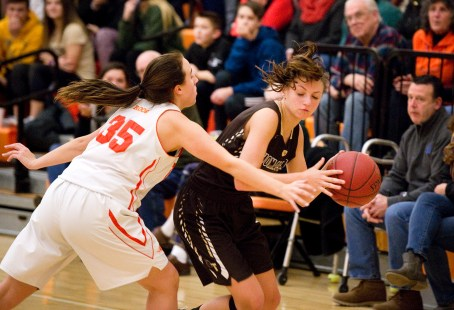 Thomaston's Emma Kahn (1) looks to drive past Terryville's Kassie McCarthy (35) during their Berkshire League match up Friday at Terryville High School. Jim Shannon Republican American