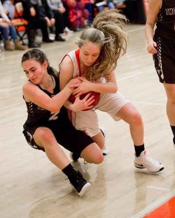 Thomaston's Sydney Stevenson (2) and Terryville's Zoe Zappone (4) battle for a loose ball during their Berkshire League match up Friday at Terryville High School. Jim Shannon Republican American