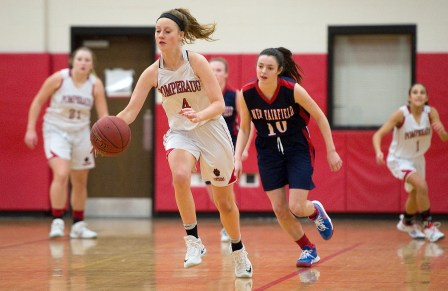 Pomperaug's Cara McGettigan (4) pushes the ball up court after stealing the ball from New Fairfield's Allison Teklits (10) during their SWC game Tuesday at Pomperaug High School. Jim Shannon Republican American