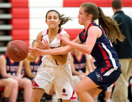 Pomperaug's Marina Lambiase (1) gets the ball knocked away by New Fairfield's Sydney O'Connor (21) during their SWC game Tuesday at Pomperaug High School. Jim Shannon Republican American