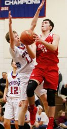Wamogo's Ethan Collins (#11) puts up a shot as Nonnewaug's Tyler Lindberg (#11) defends during Berkshire League action Thursday night at Nonnewaug High School. Wamogo easily defeated Nonnewaug. Michael Kabelka / Republican-American