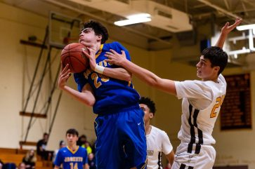 Gilbert's Hunter Smith drives to the basket against Thomaston's Drew Colavecchio #24 during a BL Boys Basketball game between Gilbert and Thomaston at Thomaston High School in Thomaston on Friday. Bill Shettle Republican-American