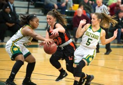 WATERBURY, CT-011819JS05- Watertown's Chloe DeFeo (34) looses the ball while truing to split the defense of Holy Cross' Ja'Lin Waters (25) and Allie Brown (5) during their game Friday at Holy Cross High School. Jim Shannon Republican American