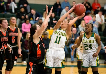WATERBURY, CT-011819JS14- Holy Cross' Hannah Brown (11) puts up a shot over Watertown's Nicole DeFeo (12) during their game Friday at Holy Cross High School. Jim Shannon Republican American