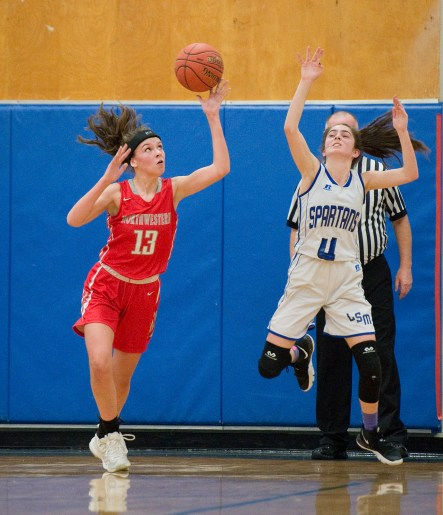 Northwestern's Emma Propfe (13) intercepts a pass intended for Lewis Mills' Lauren Alvarez (4) during their NVL match up Friday at Lewis Mills. Jim Shannon Republican American