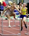 From left, Kylie Neretich of Naugatuck and Faith Rousseau of Seymour compete in the 55 meter Hurdles during the NVL indoor track championships in New Haven Monday. Steven Valenti Republican-American