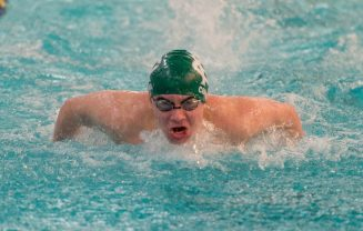 Holy Cross' Alex Corona took first place in the 100 butterfly with a time of 1:00.14 during their meet with Woodland Friday at the John Reardon Pool at Kennedy High School in Waterbury. Jim Shannon Republican American