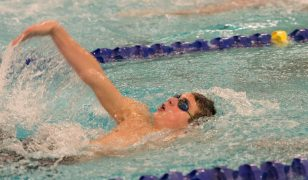 Woodland's Jake Arisian competes in the 100 backstroke during their meet with Holy Cross Friday at the John Reardon Pool at Kennedy High School in Waterbury. Jim Shannon Republican American