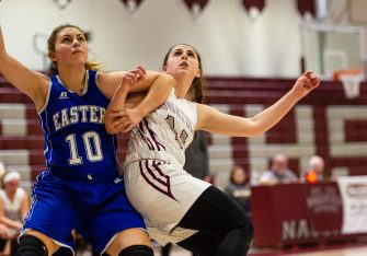 Naugatuck's Alissa McNeil #14 and Bristol Eastern's Meredith Forman #10 battle for position under the basket, during a second round tournament game in the Girls Class L Basketball Championships between Bristol Eastern and Naugatuck at Naugatuck High School in Naugatuck on Thursday. Bill Shettle Republican-American