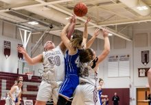 Naugatuck's Alyssa Roberts #50, left, and teammate Hailey Deitlebaum #24 battle for a rebound against Bristol Eastern's Avery Arbuckle #42, during a second round tournament game in the Girls Class L Basketball Championships between Bristol Eastern and Naugatuck at Naugatuck High School in Naugatuck on Thursday. Bill Shettle Republican-American