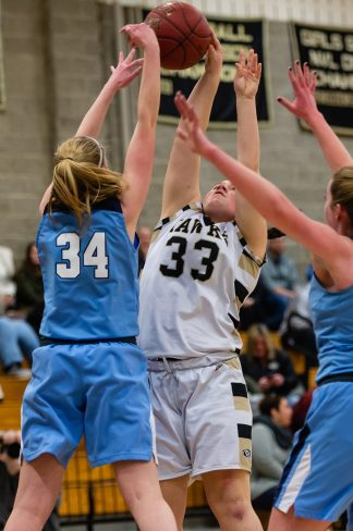 Oxford's Molly Smith #34 blocks the shot of Woodland's Riley Kane #33 during a Girls NVL Basketball game between Oxford and Woodland at Woodland Regional High School in Beacon Falls on Saturday. Oxford came back after being down by 10 at half to beat Woodland 42-39. Bill Shettle Republican-American