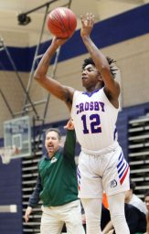 #12 Tyler Spears of Crosby High puts up the 3 pointer from the outside against Wilby High during NVL basketball action in Waterbury Monday. Steven Valenti Republican-American