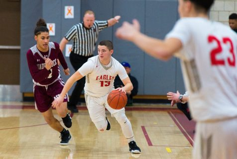 Wolcott's Chris Harris (13) drives the ball up court past Naugatuck's Andrew Robertson (11) during their NVL game Tuesday at Wolcott High School. Jim Shannon Republican American