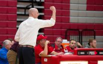 Wolcott head coach Matt Craig pumps his fist has his team hits a three-point shot during their NVL game against Naugatuck Tuesday at Wolcott High School. Jim Shannon Republican American