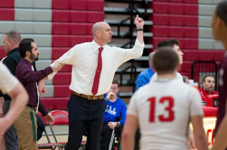 Wolcott head coach Matt Craig is held back as he yells at the referees for not calling, what he thought, was a flagrant foul during their NVL game against Naugatuck Tuesday at Wolcott High School. Jim Shannon Republican American