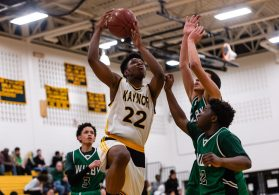 Kaynor Tech's Nashua Lovett #22 drives to the basket against Wilby defenders Jonathan Matias #23, center, and Raekwon James #22, during a non-league boys basketball game between Wilby and Kaynor Tech at Kaynor Tech High School in Waterbury on Wednesday. Kaynor Tech edged out Wilby at the end 68-58. Bill Shettle Republican-American