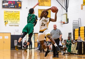 Kaynor Tech's Saijan McIntosh #24 goes high to catch an errant pass in front of Wilby's Andres Urena #3 during a non-league boys basketball game between Wilby and Kaynor Tech at Kaynor Tech High School in Waterbury on Wednesday. Kaynor Tech edged out Wilby at the end 68-58. Bill Shettle Republican-American