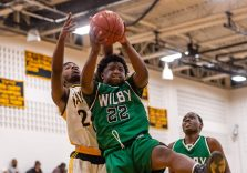Wilby's Raekwon James #22 gets good position and grabs a rebound in front of Kaynor Tech's Saijan McIntosh #24 during a non-league boys basketball game between Wilby and Kaynor Tech at Kaynor Tech High School in Waterbury on Wednesday. Kaynor Tech edged out Wilby at the end 68-58. Bill Shettle Republican-American