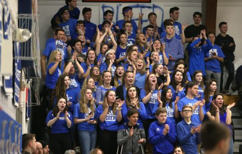 """Litchfield High School's """"Blue Crew"""" cheer on the boys varsity basketball team during the game at home against Wamogo High School on Thursday night. Emily J. Reynolds. Republican-American"""