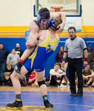 Gilbert's Evan Jackson takes down Oxford's Samuel Martino in the 160 lb. finals during the Berkshire-Valley Postseason Invitational held Saturday at the Gilbert School in Winsted. Jim Shannon Republican American