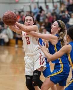 Northwestern's Francesca DeSanti (2) tries to get off a pass while being defended by Housatonic's Caroline Hurlburt (10) during their Berkshire League game Monday at Northwestern. Jim Shannon Republican American