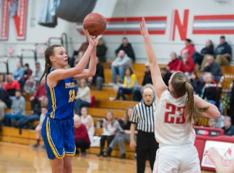 Housatonic's Sydney Segalla (13) puts up a shot over Northwestern's Jana Sanden (23) during their Berkshire League game Monday at Northwestern. Jim Shannon Republican American