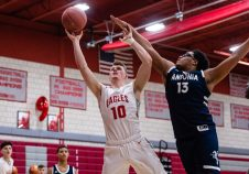 Wolcott's Jeff Nicol #10 goes to the basket against Ansonia's Martin Antoine #13, during a boys NVL basketball game between Ansonia and Wolcott at Wolcott High School in Wolcott on Wednesday. Bill Shettle Republican-American