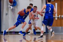 Litchfield's Tripp Melk #4 drives to the basket against Lewis Mills' Nate DiChiara #33, during a boys BL basketball game between Litchfield and Lewis Mills at Lewis Mills High School in Burlington on Thursday. Bill Shettle Republican-American