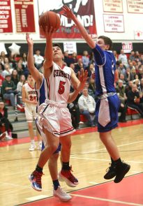 Cheshire High School's Alec Frione goes up for a shot over Southington High School's Ryan Gesnaldo during the boys varsity basketball game at Cheshire High School on Friday, Feb. 15, 2019. Emily J. Reynolds. Republican-American