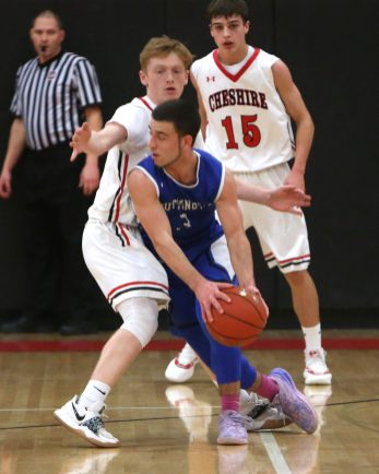 Southington High School's Colin Burdette drives to the basket through Cheshire High School's Colby Griffin during the boys varsity basketball game at Cheshire High School on Friday, Feb. 15, 2019. Emily J. Reynolds. Republican-American