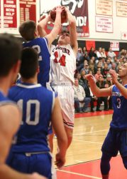 Cheshire High School's Eli Battipaglia battles for a rebound under the basket during the boys varsity basketball game at Cheshire against Southington High School on Friday, Feb. 15, 2019. Emily J. Reynolds. Republican-American