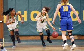#14 Maeve Perrone of Holy Cross High brings the ball up the floor s #10 Megan Condo of Seymour High defends during the NVL girls basketball tournament in Waterbury Saturday. #24 Nadia French-Graham of Holy Cross High follows the play, at left. Steven Valenti Republican-American