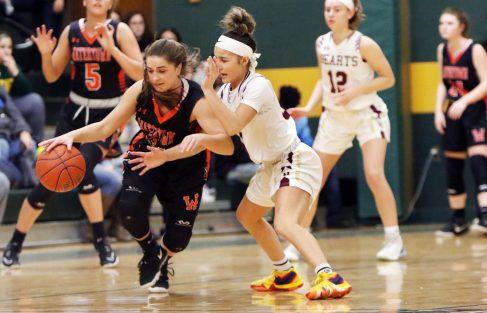 #34 Chloe DeFeo of Watertown High tries to get past #0 Aamya Rivera of Sacred Heart High during the NVL girlÕs basketball tournament in Waterbury Saturday. Steven Valenti Republican-American